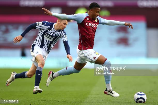 Ezri Konsa of Aston Villa is put under pressure by Conor Townsend of West Bromwich Albion during the Premier League match between Aston Villa and...