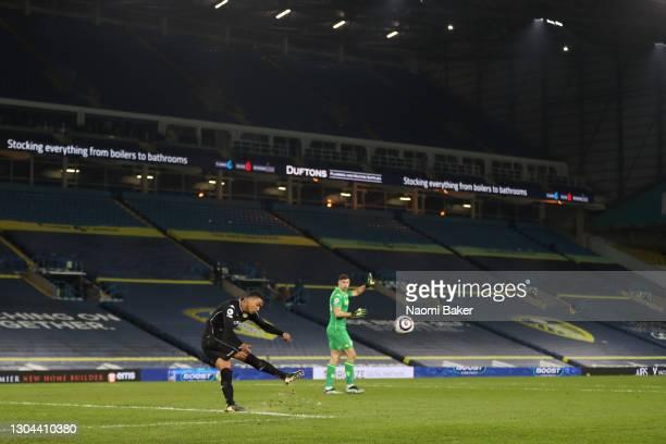 Ezri Konsa of Aston Villa takes a goal kick instead of Emiliano Martinez of Aston Villa during the Premier League match between Leeds United and...