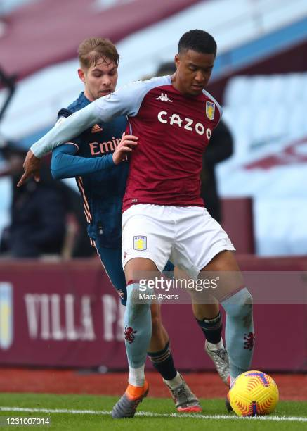 Ezri Konsa of Aston Villa tangles with Emile Smith Rowe of Arsenal during the Premier League match between Aston Villa and Arsenal at Villa Park on...