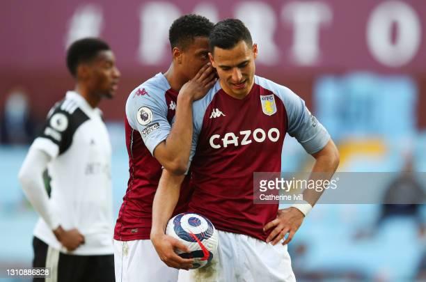 Ezri Konsa of Aston Villa whispers to Anwar El Ghazi of Aston Villa during the Premier League match between Aston Villa and Fulham at Villa Park on...