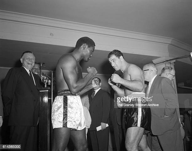 Ezzard Charles and Rocky Marciano face off after their weightin before their bout for the world heavyweight championship at Yankee Stadium in New...