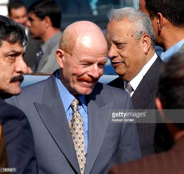 Ezzat Ibrahim an Iraqi Baath Party member second to Iraqi President Saddam Hussein is followed by Egyptian Prime Minister Atef Abeid after arriving...