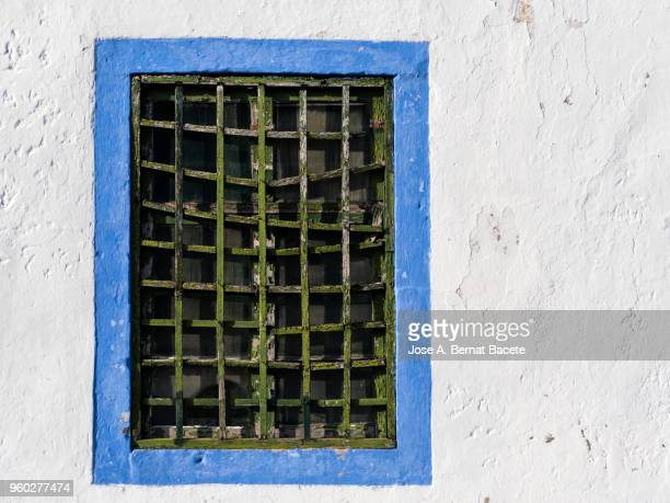 Façade of an ancient house with a window of wood of colors in the city of Angra do Heroismo, a UNESCO World Heritage Site, on Terceira Island in the Azores, Portugal.