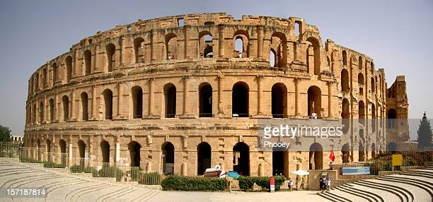 façade of el djem colosseum - amphitheater stock photos and pictures