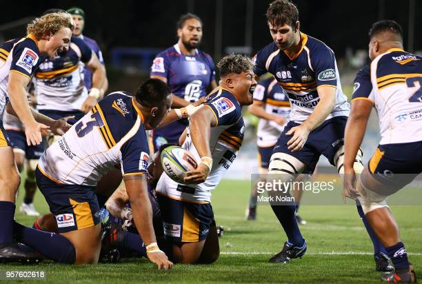 Faalelei Sione of the Brumbies celebrates scoring a try during the round 12 Super Rugby match between the Brumbies and the Rebels at GIO Stadium on...