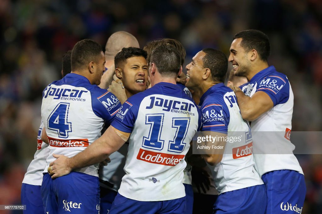 Fa'amanu Brown of the Bulldogs celebrates his try with team mates during the round 16 NRL match between the Newcastle Knights and the Canterbury Bulldogs at McDonald Jones Stadium on June 30, 2018 in Newcastle, Australia.