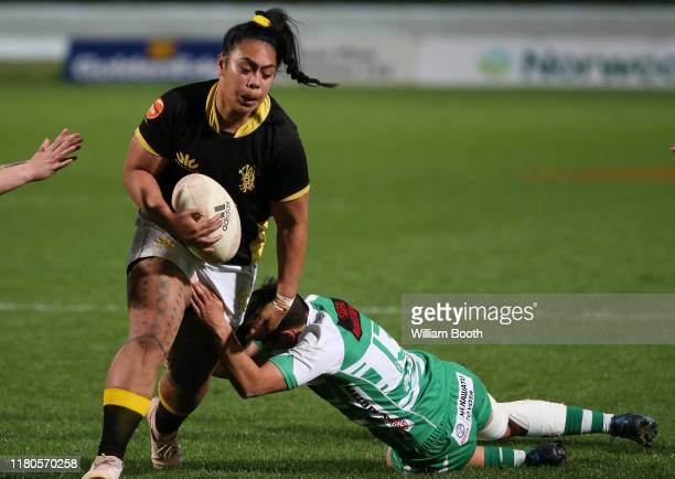 Fa'asua Makisi of Wellington is tackled during the round 7 Farah Palmer Cup match between Manawatu and Wellington at Central Energy Trust Arena on...