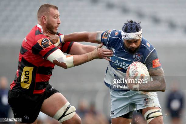 Fa'atiga Lemalu of Auckland is tackled by Luke Romano of Canterbury during the Mitre 10 Cup Premiership Final match between Auckland and Canterbury...
