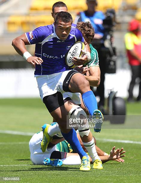 Faatoina Autagavaia of Samoa runs out of a tackle by Cornal Hendricks of South Africa during their pool C match at the fourth leg of the IRB Sevens...