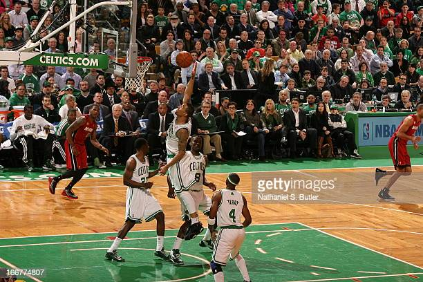 Fab Melo of the Boston Celtics goes up for the dunk against the Miami Heat during a game on March 18 2013 at TD Garden in Boston Massachusetts NOTE...