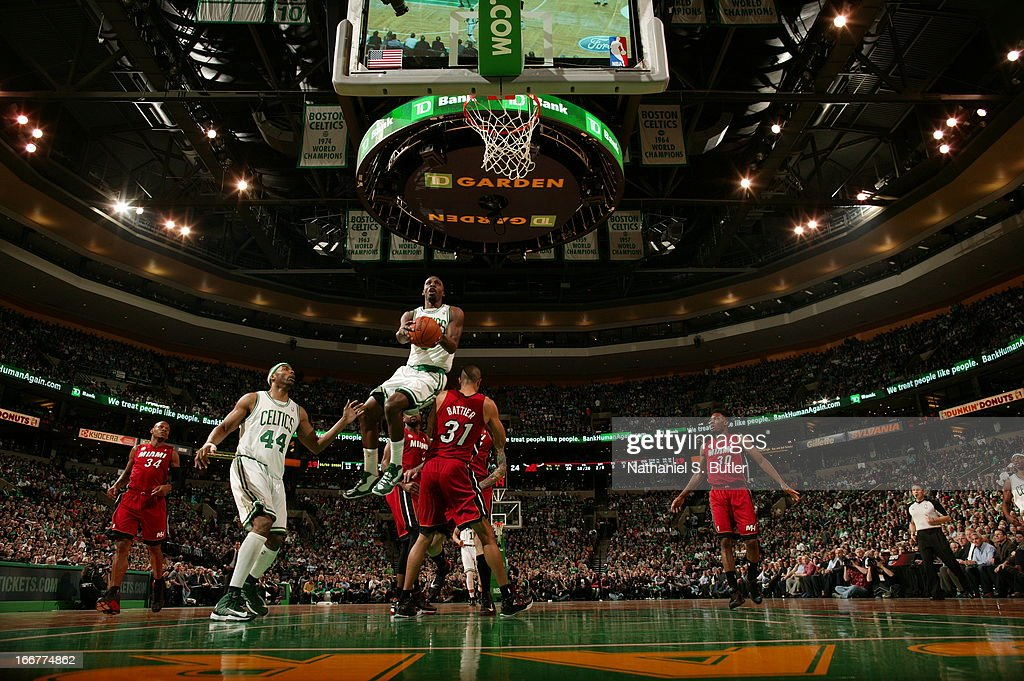 Fab Melo #13 of the Boston Celtics goes up for the easy basket against the Miami Heat during a game on March 18, 2013 at TD Garden in Boston, Massachusetts.