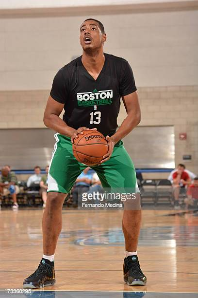 Fab Melo of the Boston Celtics shoots a free throw against the Orlando Magic during the 2013 Southwest Airlines Orlando Pro Summer League on July 12...