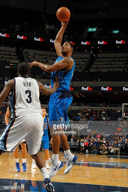Fab Melo of the Dallas Mavericks shoots against Willie Reed of the Memphis Grizzlies during a game on October 9 2013 at FedExForum in Memphis...