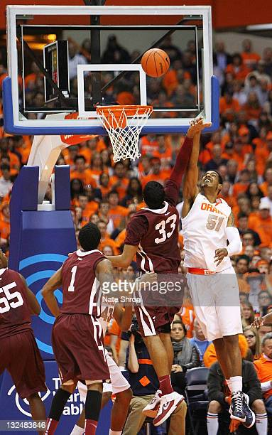 Fab Melo of the Syracuse Orange blocks the shot of Chris Gaston of the Fordham University Rams during the game at the Carrier Dome on November 12...