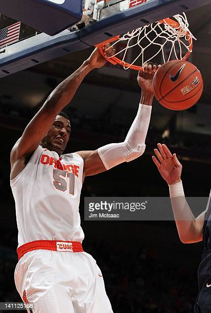 Fab Melo of the Syracuse Orange dunks against the Connecticut Huskies during their quarterfinal game of the 2012 Big East Men's Basketball Tournament...
