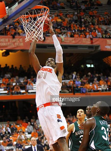 Fab Melo of the Syracuse Orange dunks the ball during the game against the Manhattan College Jaspers during the NIT Season Tipoff game at the Carrier...