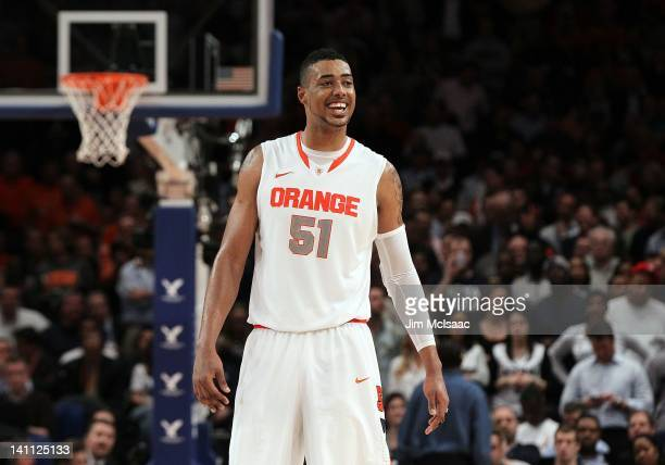 Fab Melo of the Syracuse Orange looks on against the Connecticut Huskies during their quarterfinal game of the 2012 Big East Men's Basketball...