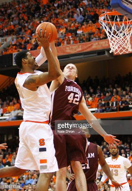 Fab Melo of the Syracuse Orange shoots the ball against Ryan Canty $42 of the Fordham University Rams during the game at the Carrier Dome on November...