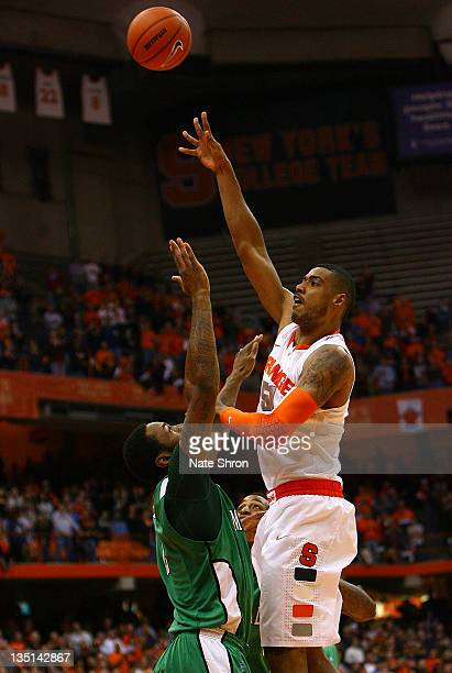 Fab Melo of the Syracuse Orange shoots the ball while being defended by Robert Goff of the Marshall Thundering Herd during the game at the Carrier...