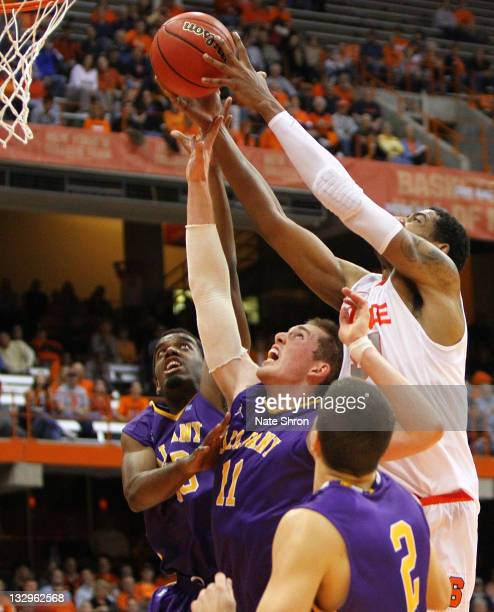 Fab Melo pushes the ball up to the basket against Luke Devlin Logan Aronhalt and Jayson Guerrier of the Albany Great Danes during the NIT Season...