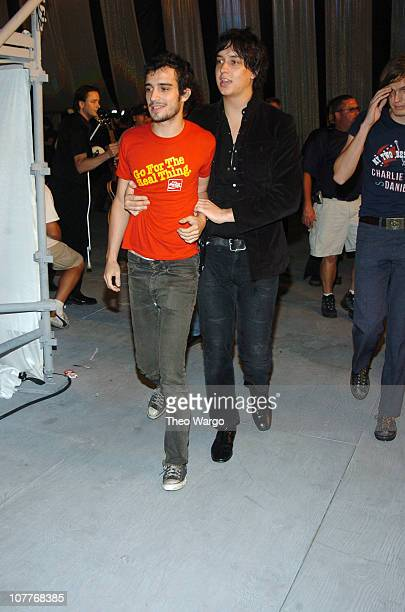 Fab Moretti of The Strokes is helped to the stage by bandmate lead singer Julian Casablancas