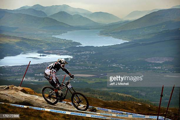 Fabbien Cousine of France competes in the men's downhill qualifying round at the UCI Mountain Bike World Cup on June 8 2013 in Fort WilliamScotland