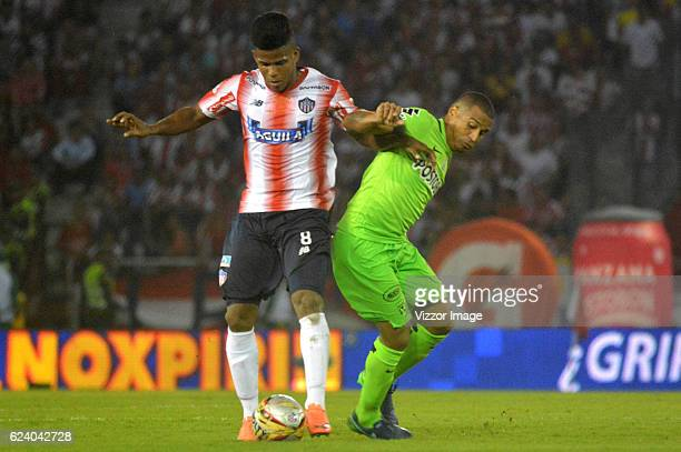 Faber Canaveral of Atletico Junior vies for the ball with MacNelly Torres of Atletico Nacional during the Final match between Junior and Atletico...