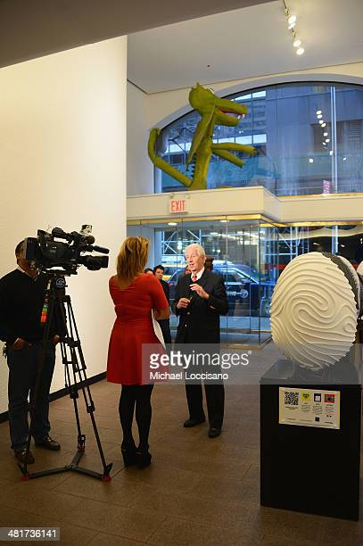 Faberge Curatorial Director Dr Geza von Habsburg is interviewed by reporter Kemberly Richardson during the 2014 Faberge Big Egg Hunt press preview at...