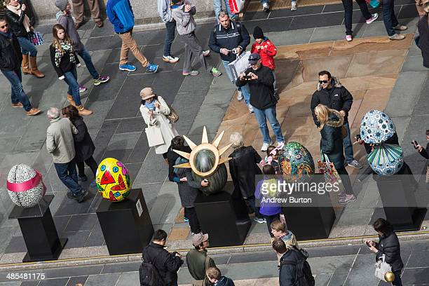 Faberge Eggs custom designed by some of the world's leading artists and designers and creativetypes are displayed at Rockefeller Plaza in celebration...