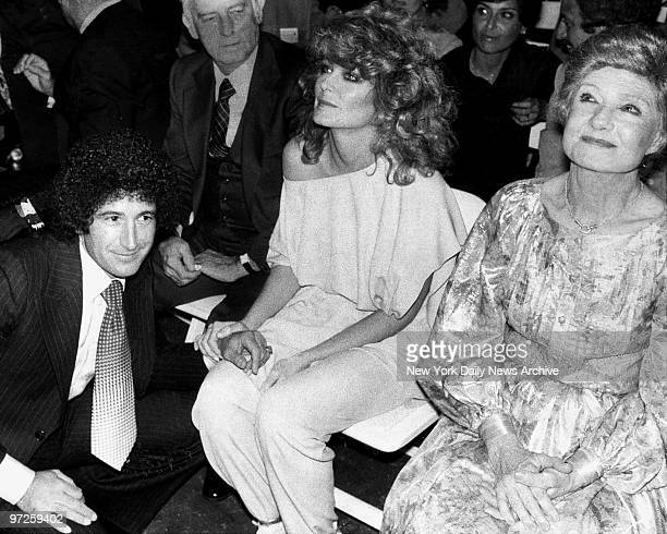 Faberge's Dick Barrie chats with Farrah Fawcett at Studio 54 where thye introduced Farrah's hair care products Farrah's mother Polly Fawcett is on...