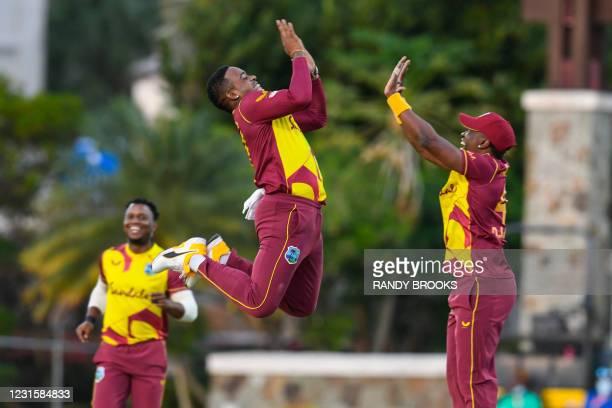 Fabian Allen and Dwayne Bravo of West Indies celebrate the dismissal of Danushka Gunathilaka of Sri Lanka during the 3rd and final T20i match between...
