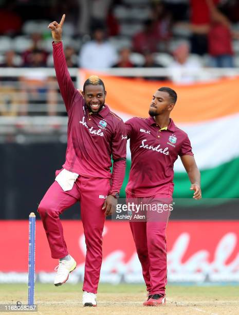 Fabian Allen and Nicholas Pooran of the West Indies celebrate a wicket during the third MyTeam11 ODI between the West Indies and India at the Queen's...