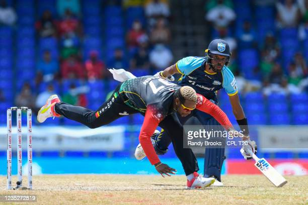 Fabian Allen of Saint Kitts & Nevis Patriots and Roston Chase of Saint Lucia Kings collided during the 2021 Hero Caribbean Premier League Final match...