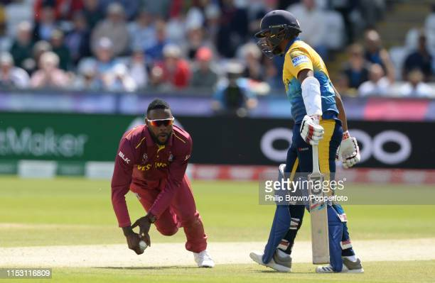Fabian Allen of the West Indies celebrates after catching Kusal Mendis of Sri Lanka as Avishka Fernando looks on during the ICC Cricket World Cup...