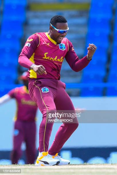 Fabian Allen of West Indies celebrates the dismissal of Dinesh Chandimal of Sri Lanka during the 1st ODI match between West Indies and Sri Lanka at...