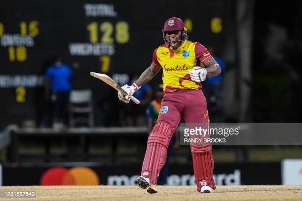 Fabian Allen of West Indies celebrates winning the 3rd and final T20i match between Sri Lanka and West Indies at Coolidge Cricket Ground in Osbourn,...