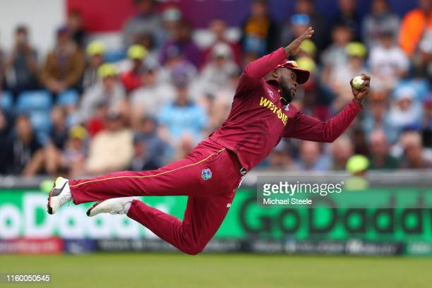 Fabian Allen of West Indies takes a spectacular catch off the bowling of Oshane Thomas to take the last Afghanistan wicket of Sayad Ahmad Shirzad...