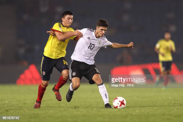 Fabian Angel of Colombia and Elias Abouchabaka of Germany battle for the ball during the FIFA U17 World Cup India 2017 Round of 16 match between...