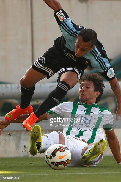 Fabian Ariel Orellana of RC Celta de Vigo beats Ryder Matos of Cordoba CF during the La liga match between Cordoba CF and RC Celta de Vigo at El...