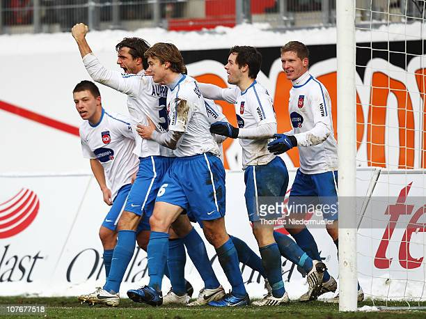 Fabian Aupperle of Heidenheim celebrates his goal with his teammates during the Third League match between 1.FC Heidenheim and Carl Zeiss Jena at the...