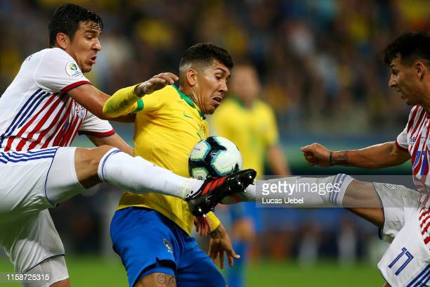 Fabian Balbuena and Hernan Perez of Paraguay fights for the ball with Roberto Firmino of Brazil during the Copa America Brazil 2019 quarterfinal...