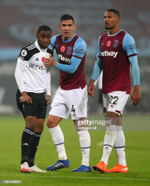 Fabian Balbuena and Sebastian Haller of West Ham United console Ademola Lookman of Fulham after he misses a penalty during the Premier League match...