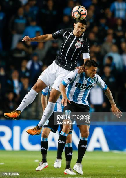Fabian Balbuena of Corinthians fights for the ball with Enrique Triverio of Racing Club during a second leg match between Racing Club and Corinthians...