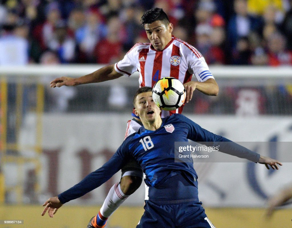 Fabian Balbuena #4 of Paraguay battles Andrija Novakovich #18 of United States for a header during their game at WakeMed Soccer Park on March 27, 2018 in Cary, North Carolina. The United States won 1-0.