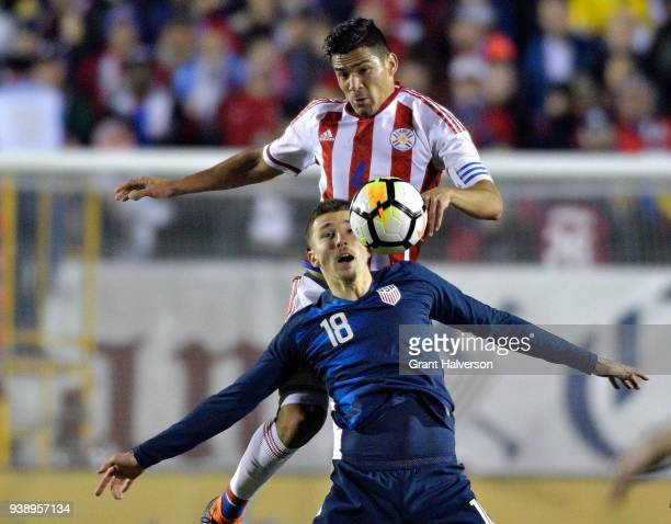 Fabian Balbuena of Paraguay battles Andrija Novakovich of United States for a header during their game at WakeMed Soccer Park on March 27 2018 in...