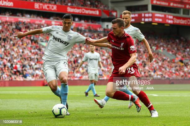 Fabian Balbuena of West Ham United and Andrew Robertson of Liverpool during the Premier League match between Liverpool FC and West Ham United at...