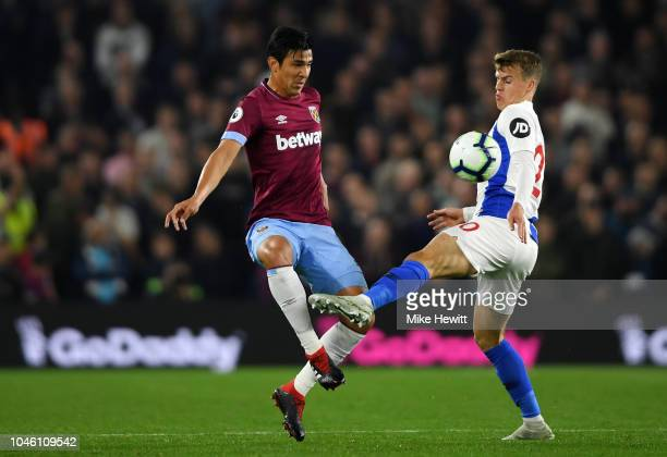 Fabian Balbuena of West Ham United and Solomon March of Brighton and Hove Albion in action during the Premier League match between Brighton Hove...