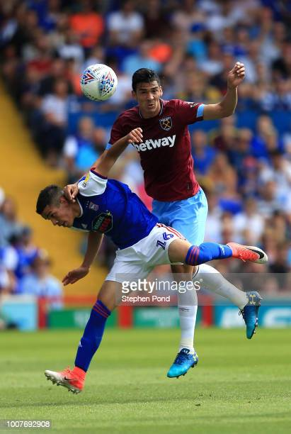 Fabian Balbuena of West Ham United and Tristan Nydam of Ipswich Town compete for the ball during the preseason friendly match between Ipswich Town...