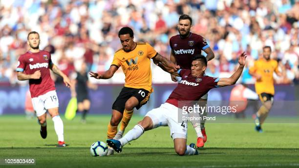 Fabian Balbuena of West Ham United tackles Helder Costa of Wolverhampton Wanderers during the Premier League match between West Ham United and...