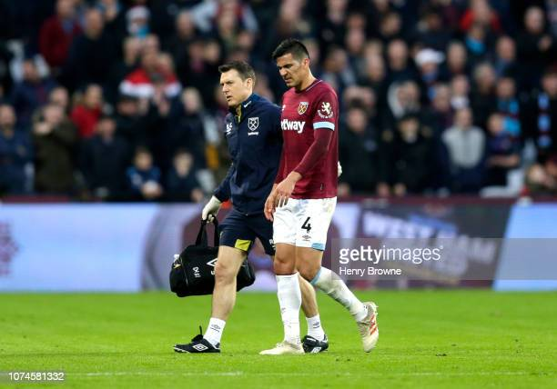 Fabian Balbuena of West Ham United walks off injured during the Premier League match between West Ham United and Watford FC at London Stadium on...